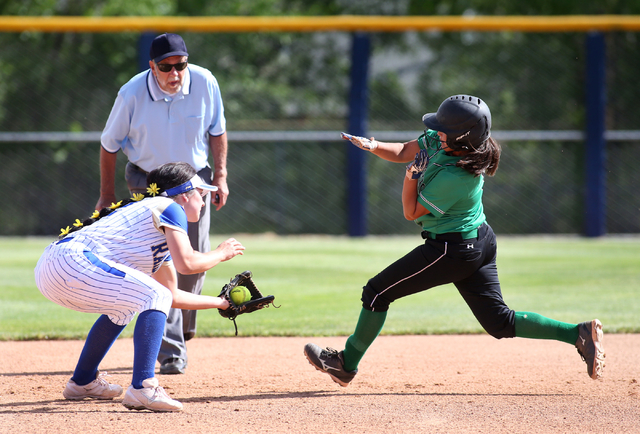 Rancho's Lili Gutierrez gets tagged out by Reed's Kenzi Goins during NIAA DI softball action at UNR in Reno on Thursday, May 19, 2016. Reed won 2-0. Cathleen Allison/Las Vegas Review-Journal