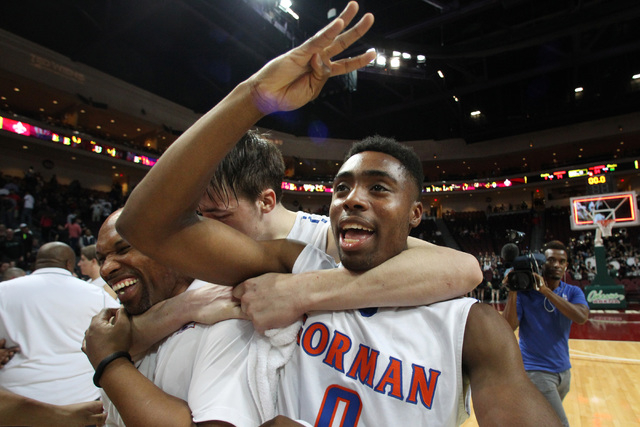 Bishop Gorman guard Ugo Amadi signals a fourth consecutive championship while being hugged by Stephen Zimmerman after their Division I state championship game against Palo Verde Friday, Feb. 27, 2 ...