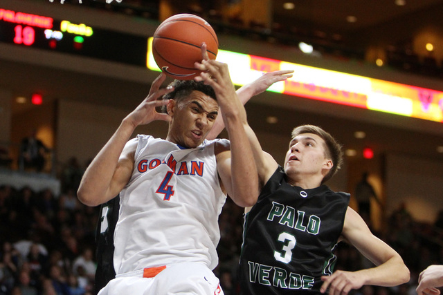 Bishop Gorman center Chase Jeter and Palo Verde forward Furious Fernandes fight for a rebound during their Division I state championship game Friday, Feb. 27, 2015, at the Orleans Arena.  (Sam Mor ...