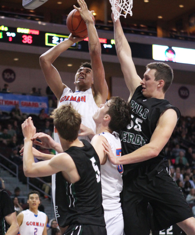 Bishop Gorman center Chase Jeter drives to the basket against Palo Verde during their Division I state championship game Friday, Feb. 27, 2015, at the Orleans Arena.  (Sam Morris/Las Vegas Review- ...