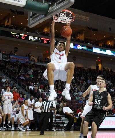 Bishop Gorman center Chae Jeter dunks on Palo Verde during their Division I state championship game Friday, Feb. 27, 2015, at the Orleans Arena.  (Sam Morris/Las Vegas Review-Journal)