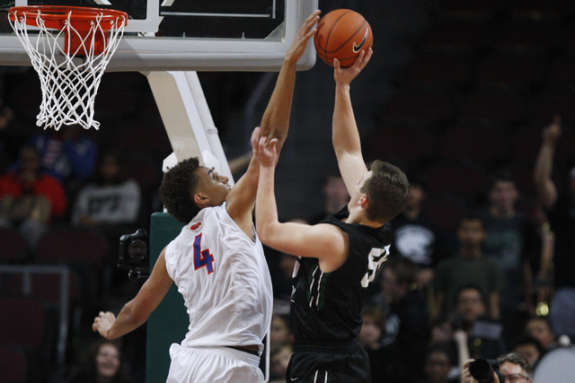Bishop Gorman center Chase Jeter blocks a shot by Palo Verde forward Kyler Hack during their Division I state championship game Friday, Feb. 27, 2015, at the Orleans Arena.  (Sam Morris/Las Vegas  ...