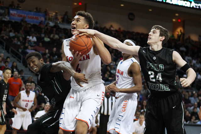 Bishop Gorman center Chase Jeter is defended by Palo Verde forward Jamell Garcia-Williams while being fouled by guard Ryan Vogelei during their Division I state championship game Friday, Feb. 27,  ...