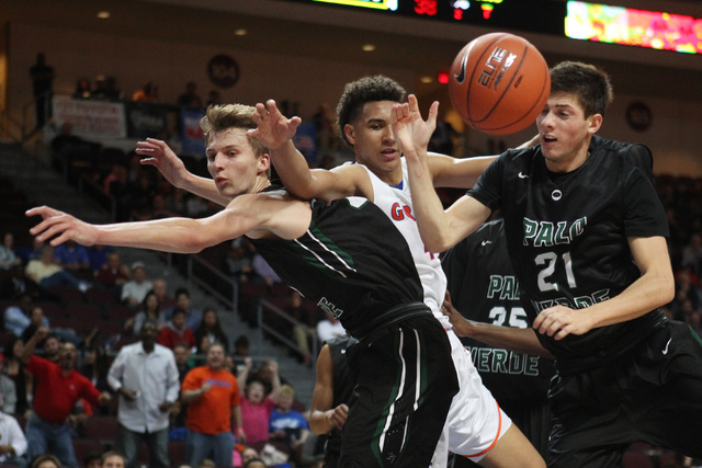 Bishop Gorman center Chase Jeter and Palo Verde forwards Grant Dressler, left, and Connor Lemmon collide while chasing a rebound during their Division I state championship game Friday, Feb. 27, 20 ...