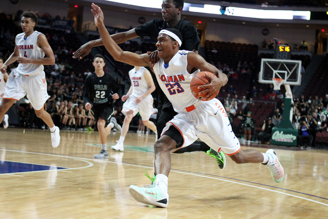 Bishop Gorman guard Nick Blair is grabbed by Palo Verde forward Jamell Garcia-Williams during their Division I state championship game Friday, Feb. 27, 2015, at the Orleans Arena.  (Sam Morris/Las ...