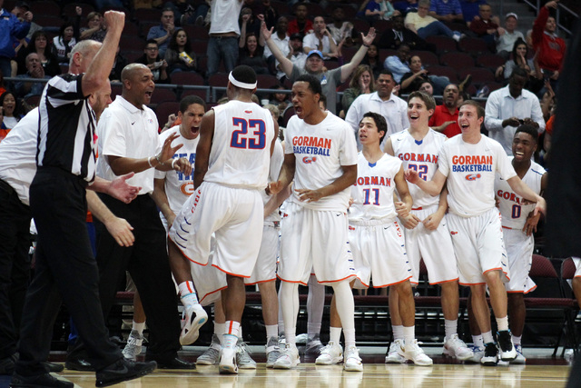 The Bishop Gorman bench celebrates after guard Nick Blair scored and drew a foul on Palo Verde during their Division I state championship game Friday, Feb. 27, 2015, at the Orleans Arena.  (Sam Mo ...