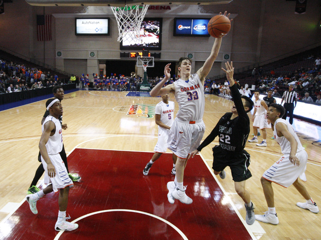 Bishop Gorman centers Stephen Zimmerman and Chase Jeter defend a shot by Palo Verde guard Taylor Miller during their Division I state championship game Friday, Feb. 27, 2015, at the Orleans Arena. ...