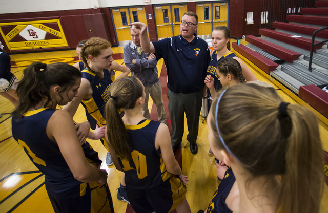Boulder City girls basketball coach Paul Dosch talks with his players during a basketball game at Del Sol High School in Las Vegas on Tuesday, Jan. 10, 2017. Dosch, 44, who has been coaching the t ...