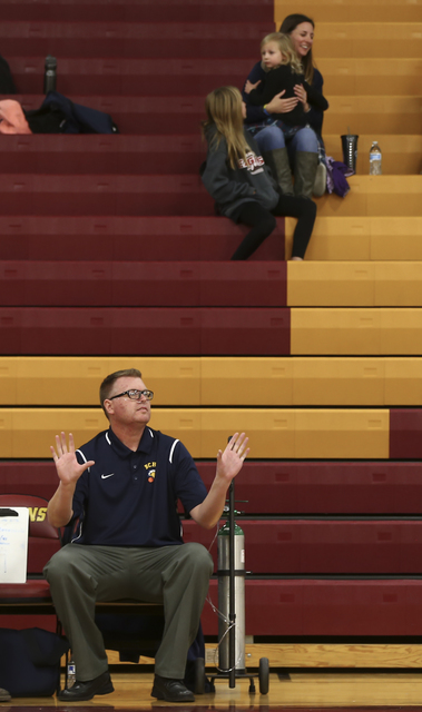 Boulder City girls basketball coach Paul Dosch shouts to motions to his players during a basketball game at Del Sol High School in Las Vegas on Tuesday, Jan. 10, 2017. Dosch, 44, who has been coac ...