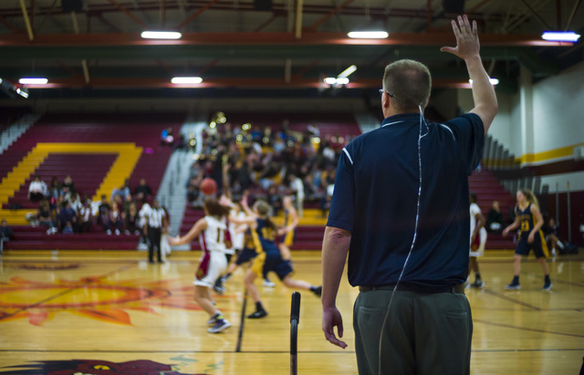 Boulder City girls basketball coach Paul Dosch motions to his players during a basketball game at Del Sol High School in Las Vegas on Tuesday, Jan. 10, 2017. Dosch, 44, who has been coaching the t ...