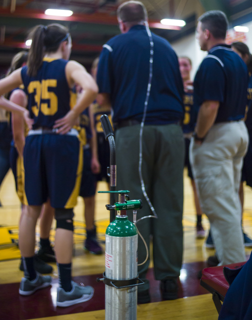 Boulder City girls basketball coach Paul Dosch talks to players during a basketball game at Del Sol High School in Las Vegas on Tuesday, Jan. 10, 2017. Dosch, 44, who has been coaching the team fo ...