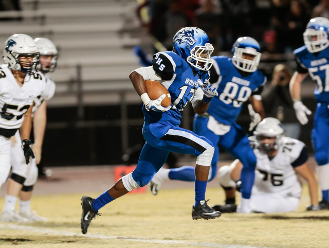 Basic senior Quison Owens (17) runs the ball as Foothill defensive players look on, during  the Sunrise Region semifinal football game held at Basic High School in Henderson, Thursday, Nov. 10, 20 ...