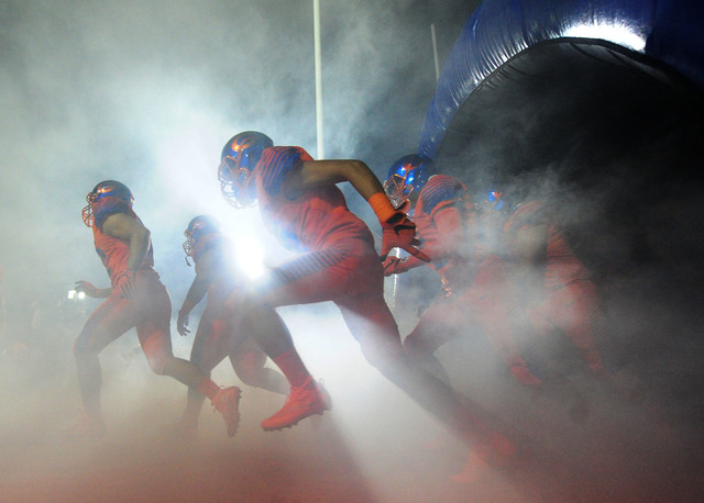 Bishop Gorman players take the field before the start of their prep football game against St. Thomas Aquinas Fla. at Bishop Gorman High School in Las Vegas Friday, Sept. 30, 2016. Josh Holmberg/La ...