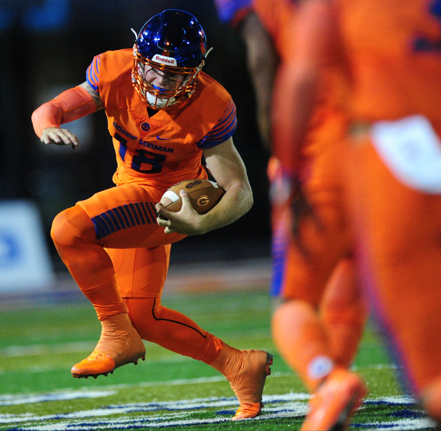 Bishop Gorman quarterback Tate Martell scrambles  against St. Thomas Aguinas, Fla.  in the first half of their prep football game at Bishop Gorman High School in Las Vegas Friday, Sept. 30, 2016.  ...