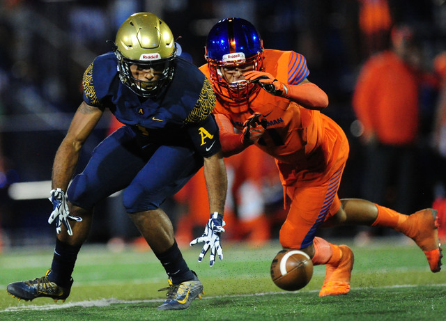 St. Thomas Aguinas, Fla. wide receiver Jordan Merrell, left, is unable to catch a low pass while Bishop Gorman safety Bubba Bolden defends in the first half of their prep football game at Bishop G ...