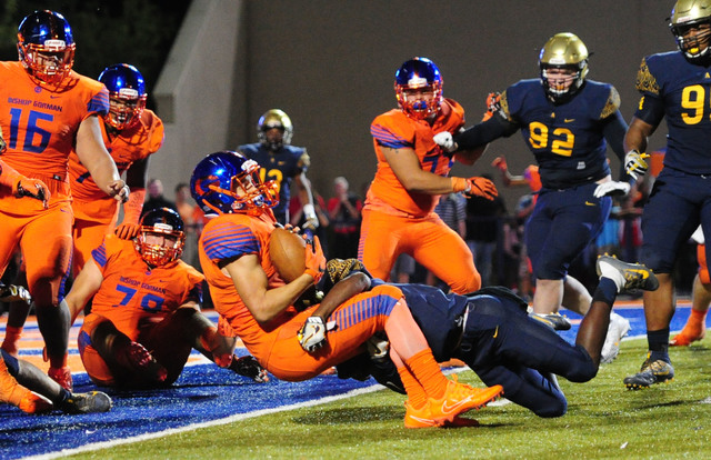 Bishop Gorman running back Biaggio Ali Walsh scores the winning 2-point conversion in triple overtime against St. Thomas Aguinas, Fla. during their prep football game at Bishop Gorman High School  ...