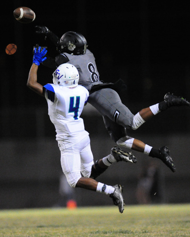Green Valley wide receiver T.J. Saxon (4) is unable to make a catch while Palo Verde defensive back Jamil Patton defends (9) in the first half of their prep football game at Palo Verde  High Schoo ...