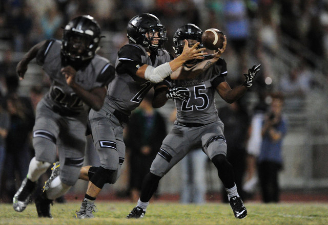 Palo Verde quarterback Jonathan Schofield (2)  bobbles the snap as running back Terrill Jimerson looks on in the first half of their prep football game against Green Valley at Palo Verde  High Sch ...