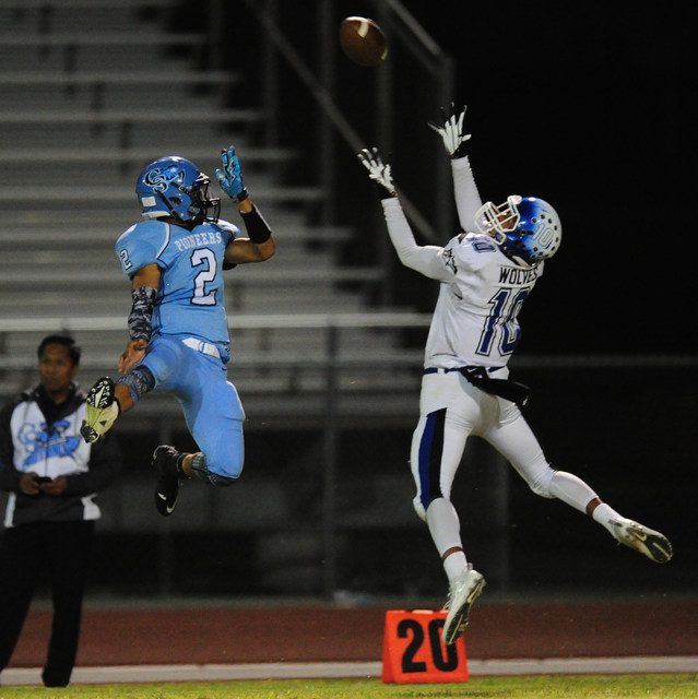 Basic High School wide receiver Xavier Caduto (10) is unable to catch a pass as Canyon Springs High School safety Diamante Burton defends in the first half of their prep football game  at Canyon S ...