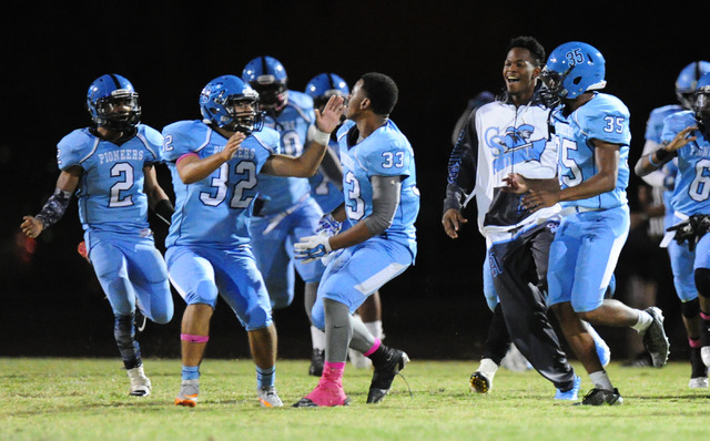 Canyon Springs players celebrate after kicker Cesar Barron-Rodriguez (32) kicked the game winning field goal against Basic in overtime  of their prep football game  at Canyon Springs High School i ...