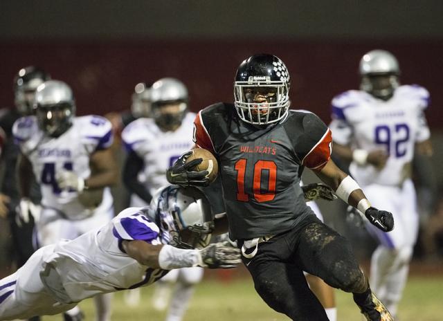 Las Vegas' Elijah Hicks (10) breaks the tackle of Silverado's Taison Etienne (13) during the Sunrise Region quarterfinals on Friday, Nov. 4, 2016, at Las Vegas High School, in Las Vegas. (Benjamin ...