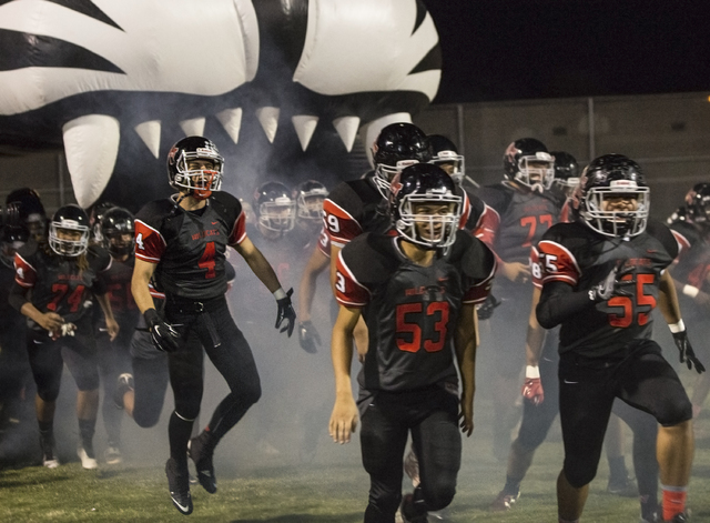Las Vegas High School players runs onto the field during the Sunrise Region quarterfinals on Friday, Nov. 4, 2016, at Las Vegas High School, in Las Vegas. (Benjamin Hager/Las Vegas Review-Journal)