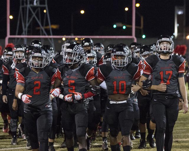 Las Vegas High School players walk arm-in-arm onto the field during the Sunrise Region quarterfinals on Friday, Nov. 4, 2016, at Las Vegas High School, in Las Vegas.  (Benjamin Hager/Las Vegas Rev ...