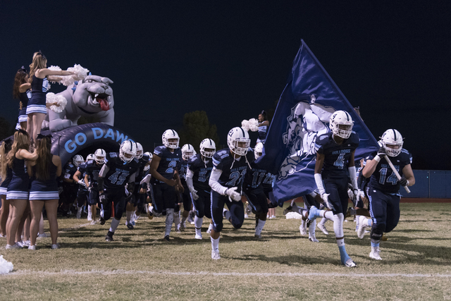 Centennial players take the field during a football game against Legacy at Centennial in Las Vegas, Friday, Sept. 30, 2016. Jason Ogulnik/Las Vegas Review-Journal