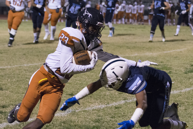 Legacy's Marcus Brown (23) runs with the ball during a football game at Centennial in Las Vegas, Friday, Sept. 30, 2016. Jason Ogulnik/Las Vegas Review-Journal