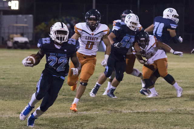 Centennial's Kayvon Miller (22) runs with the ball during a football game against Legacy at Centennial in Las Vegas, Friday, Sept. 30, 2016. Jason Ogulnik/Las Vegas Review-Journal