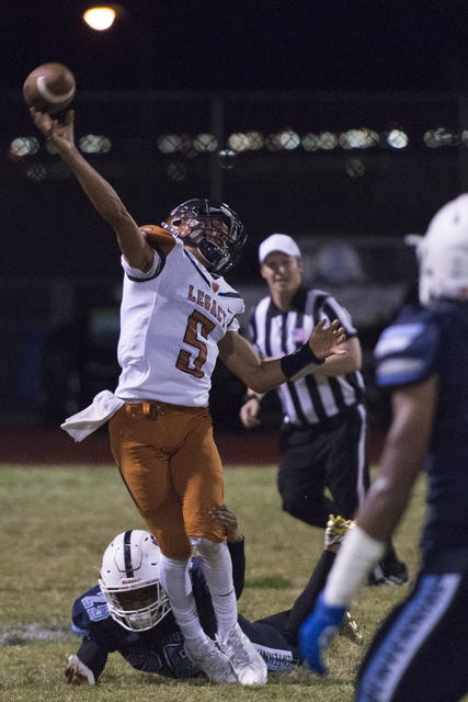 Legacy's Roberto Valenzuela (5) throws the ball during a football game at Centennial in Las Vegas, Friday, Sept. 30, 2016. Jason Ogulnik/Las Vegas Review-Journal