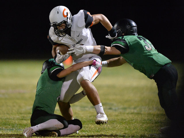 Chaparral receiver Devin Gaddy (9) is tackled during the Virgin Valley High School Chaparral High School High School game at Virgin Valley High School in Mesquite, Nev., on Friday, Oct. 14, 2016.  ...