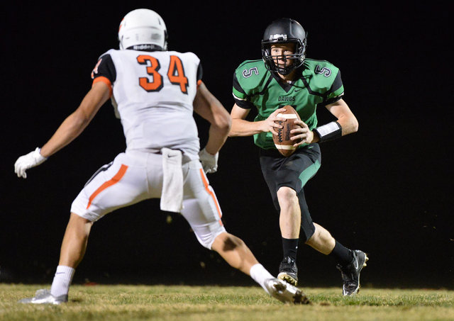 Virgin Valley quarterback Cade Anderson (5) runs an option during the Virgin Valley High School Chaparral High School High School game at Virgin Valley High School in Mesquite, Nev., on Friday, Oc ...