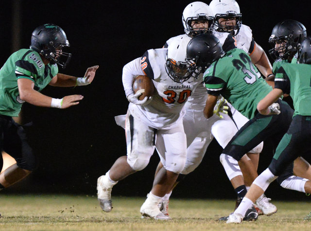 Chaparral running back Jacob Ford (30) carries the ball during the Virgin Valley High School Chaparral High School High School game at Virgin Valley High School in Mesquite, Nev., on Friday, Oct.  ...