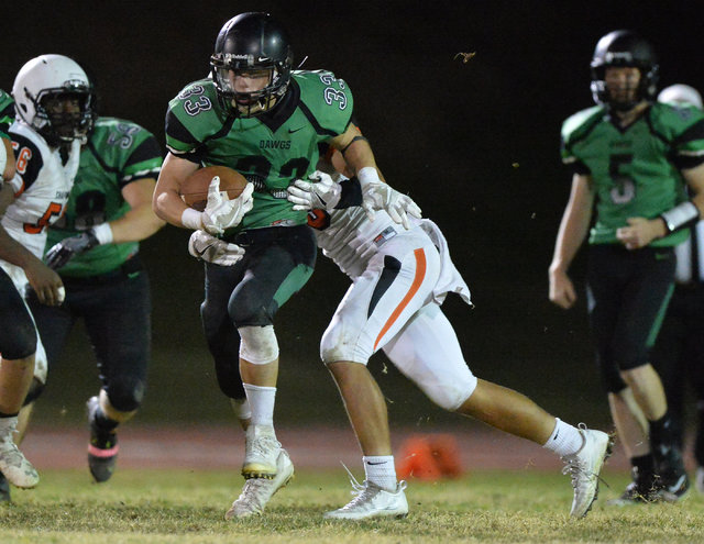 Virgin Valley running back Maurice Jayden Perkins (33) runs the ball during the Virgin Valley High School Chaparral High School High School game at Virgin Valley High School in Mesquite, Nev., on  ...