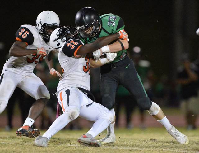 Virgin Valley running back Maurice Jayden Perkins (33) hits a defender during the Virgin Valley High School Chaparral High School High School game at Virgin Valley High School in Mesquite, Nev., o ...