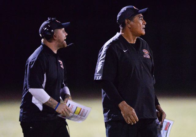 Chaparral head coach Paul Nihipali, right, watches his team play during the Virgin Valley High School Chaparral High School High School game at Virgin Valley High School in Mesquite, Nev., on Frid ...