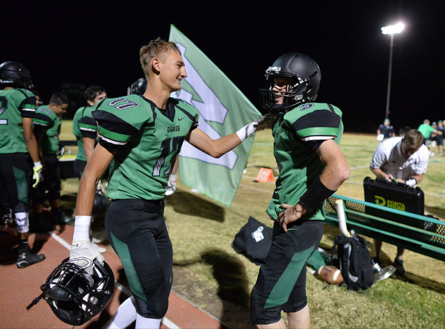 Virgin Valley quarterback Cade Anderson (5) is congratulated by receiver Logan Felix (17) after beating Chaparral High School High School at Virgin Valley High School in Mesquite, Nev., on Friday, ...