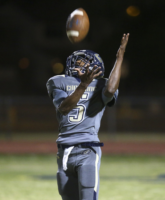 Cheyenne's Deriontae Green (5) catches the ball while playing against Chaparral during a football game at Cheyenne High School in Las Vegas on Thursday, Oct. 27, 2016. Chase Stevens/Las Vegas Revi ...