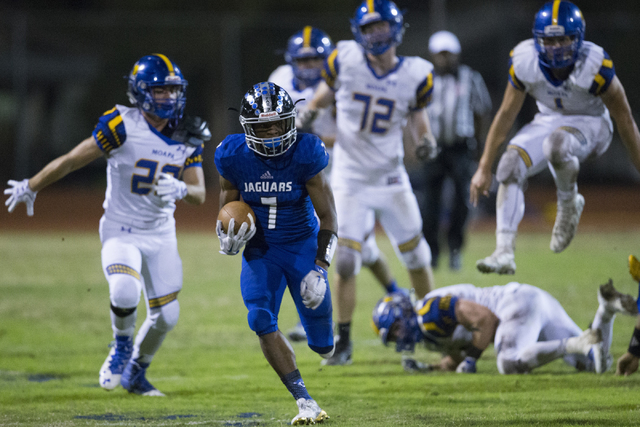 Desert Pines running back Isaiah Morris (7) runs the ball against Moapa Valley in their state quarterfinal football game at Desert Pines High School on Friday, Nov. 4, 2016, in Las Vegas. Desert P ...