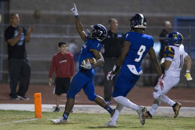 Desert Pines running back Isaiah Morris (7) gestures as he scores a touchdown against Moapa Valley in their state quarterfinal football game at Desert Pines High School on Friday, Nov. 4, 2016, in ...