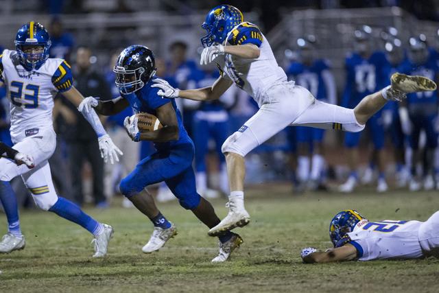 Desert Pines wide receiver Isaiah Morris (7) runs the ball against Moapa Valley in their state quarterfinal football game at Desert Pines High School on Friday, Nov. 4, 2016, in Las Vegas. Desert  ...
