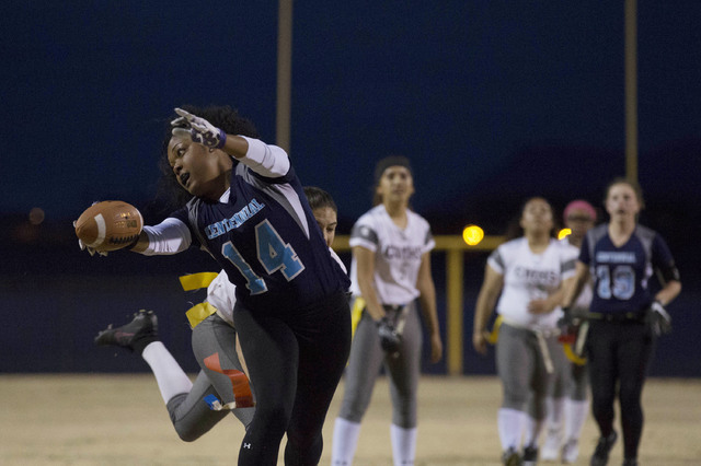 Centennial senior LeNae Thomas gets attempts to run the ball, but tagged by Cimarron-Memorial at Centennial High School on Thursday, Feb. 9, 2017, in Las Vegas. (Bridget Bennett/Las Vegas Review-J ...