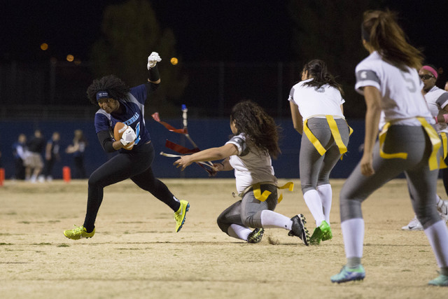 Centennial senior Chantay Dixon attempts to run the ball during a game against Cimarron-Memorial at Centennial High School on Thursday, Feb. 9, 2017, in Las Vegas. (Bridget Bennett/Las Vegas Revie ...