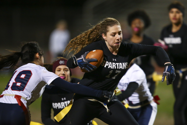 Cimarron-Memorial's Alyssa Karpinski (17) evades Coronado's Sofia Herrera (19) during the Class 4A state championship flag football game at Cimarron-Memorial High School on Wednesday, Feb. 22, 201 ...