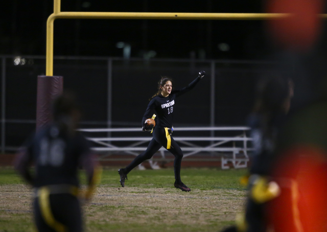 Cimarron-Memorial's Haylei Hughes (18) celebrates after scoring a touchdown on an interception during the Class 4A state championship flag football game at Cimarron-Memorial High School on Wednesd ...