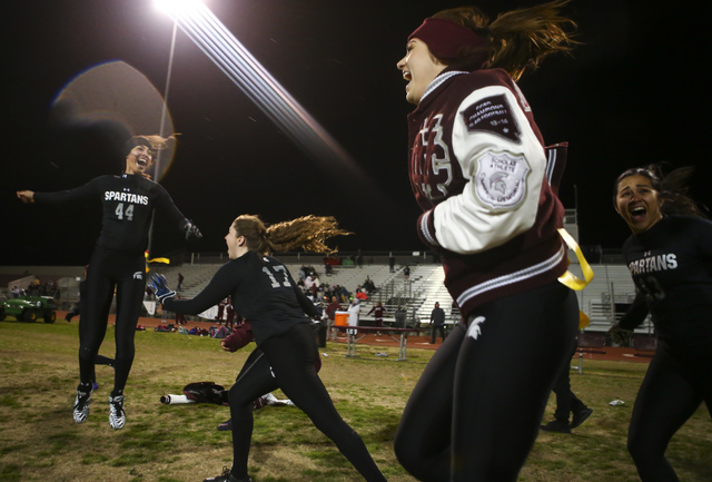 Cimarron-Memorial players, including Tiarra Del Rosario (44) and Alyssa Karpinski (17), celebrate after defeating Coronado 24-7 in the Class 4A state championship flag football game at Cimarron-Me ...