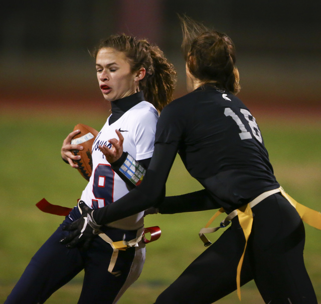 Cimarron-Memorial's Haylei Hughes (18) tags out Coronado's Caitlin Shannon (9) during the Class 4A state championship flag football game at Cimarron-Memorial High School on Wednesday, Feb. 22, 201 ...