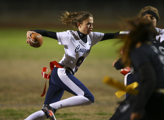 Coronado's Caitlin Shannon (9) runs the ball during the Class 4A state championship flag football game at Cimarron-Memorial High School on Wednesday, Feb. 22, 2017. Cimarron-Memorial won 24-7. (Ch ...