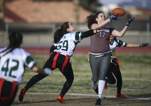 Cimarron-Memorial's Alyssa Karpinski (17) reels in the ball as Palo Verde's Grace Cashin (59) tries to break up the pass during the Sunset Region flag football championship game at Green Valley Hi ...